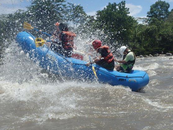 A group of travellers tackle a rapid in their raft on the Amazon river.