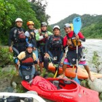Six experienced local guides by the Amazon river in their safety gear with their kayaks.