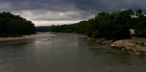 A photo looking along the Amazon river with a dramatic sky.