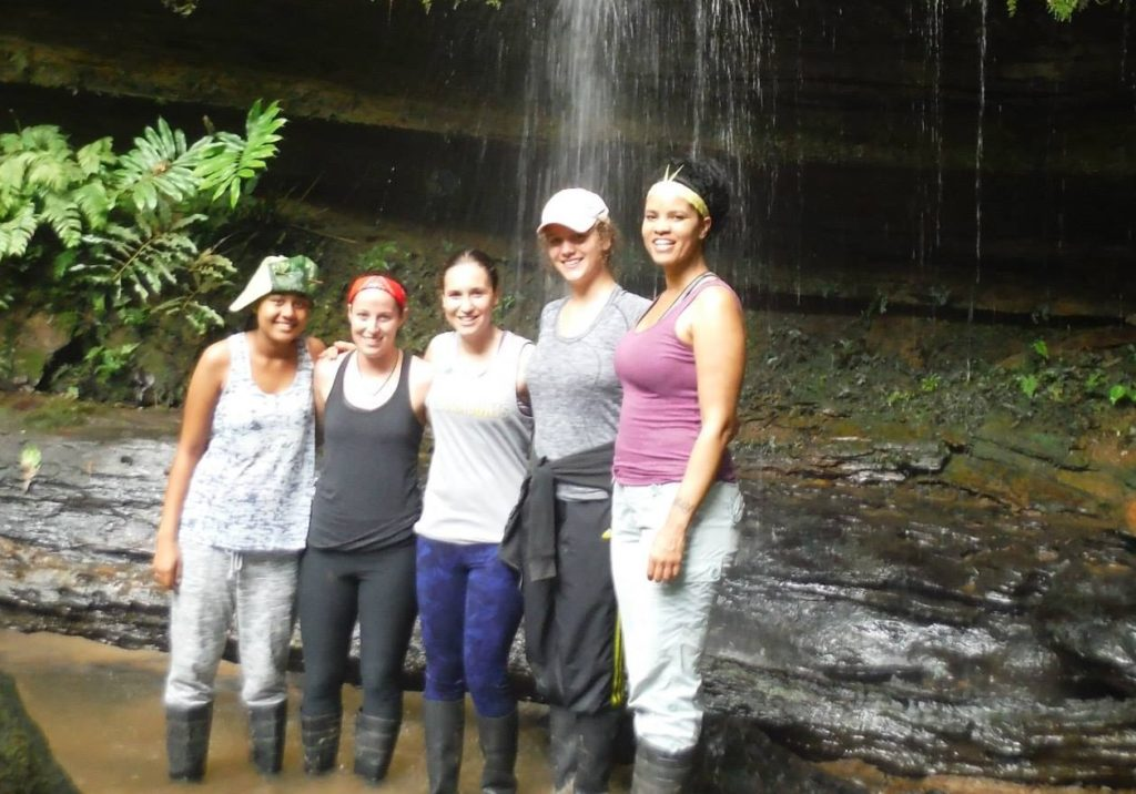 A group of five stand in a canyon in the Amazon jungle.